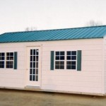 White and Green Shed with Doubled Front Windows and 15 Lite Door