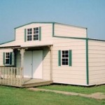 Tan and Green Storage Shed with Center Loft